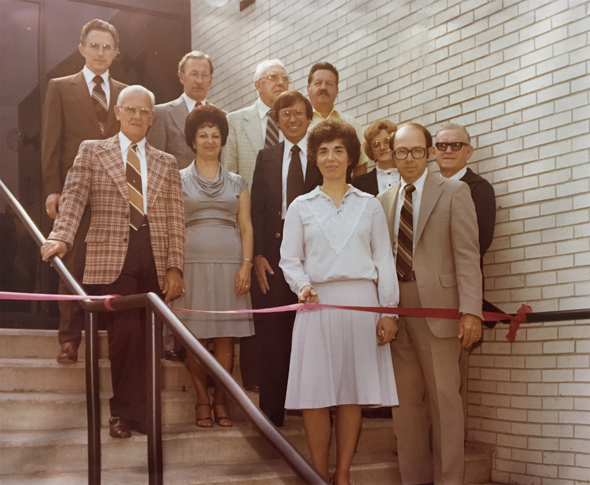 Image: Old photo of a ribbon cutting at BWFCU main office expansion
