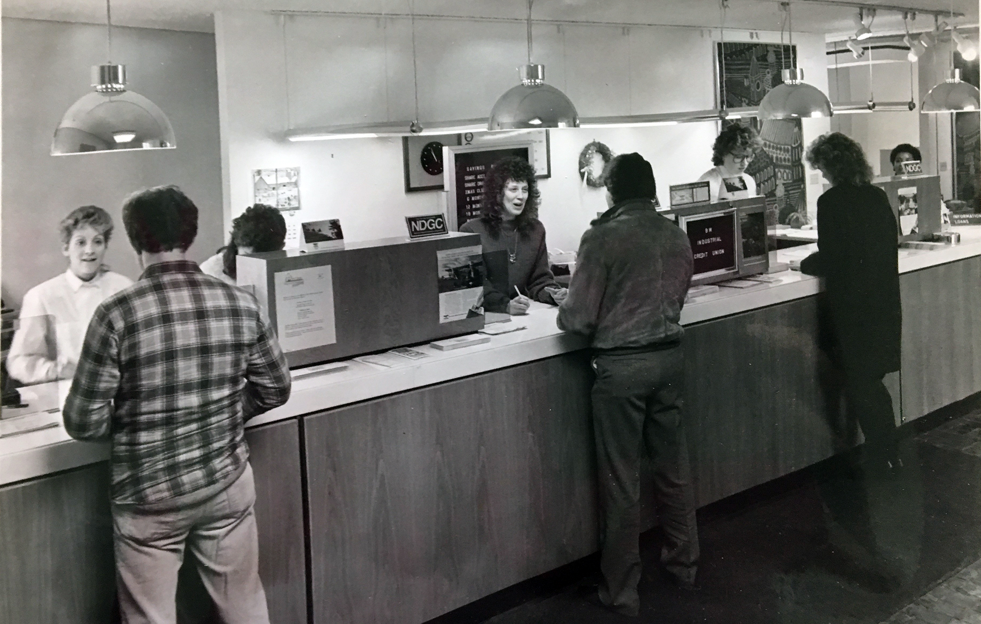 Image: Old photo of members transacting in Elyria office