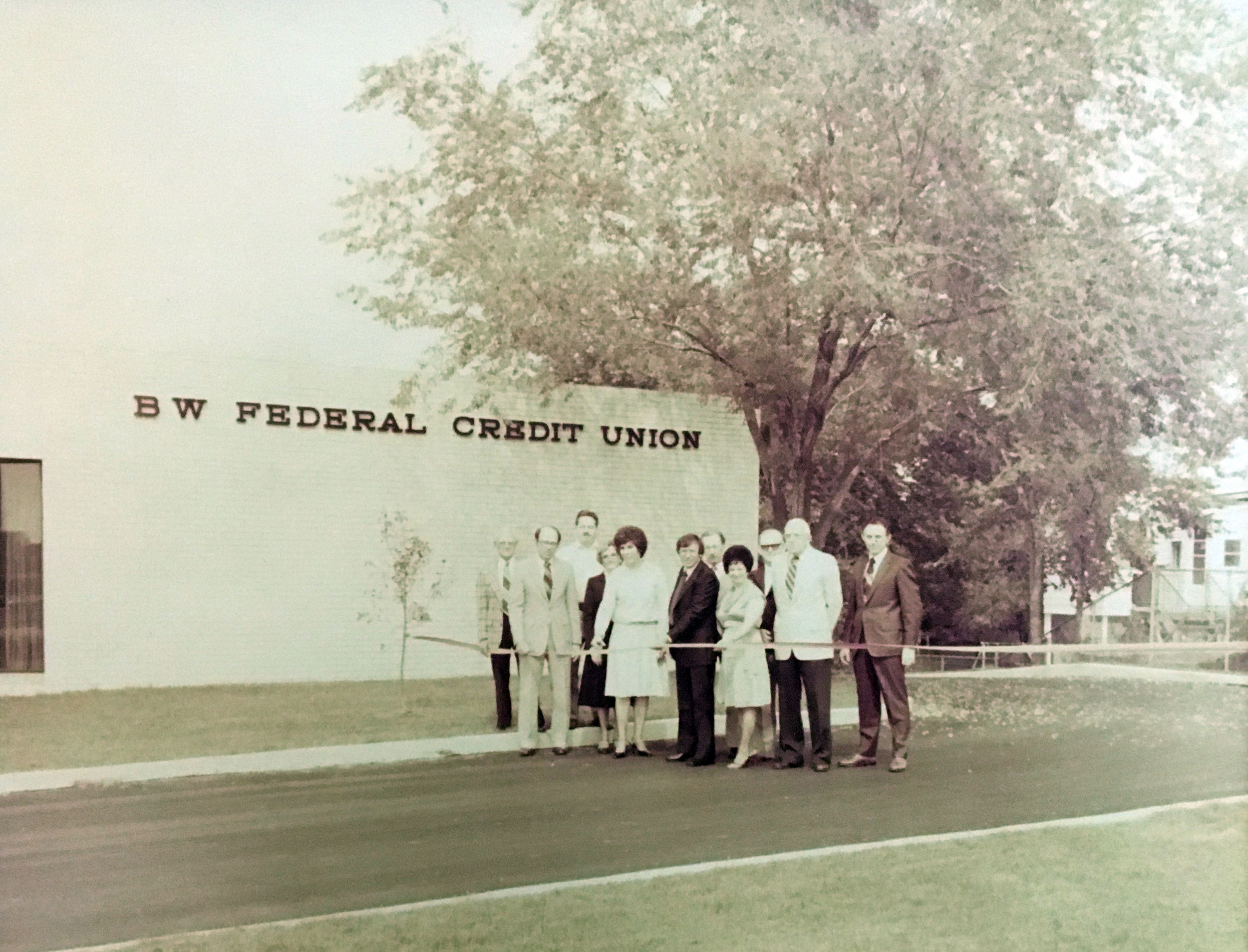Image: Old photo of a ribbon cutting at BWFCU